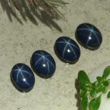 thumb image of 1.1ct Oval Cabochon Dark Blue Star Sapphire (ID: 489817)